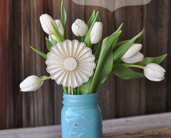 Beautify a bouquet with a DIY paper medallion.