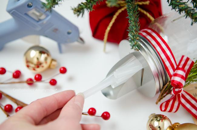 DIY Mason Jar glue stick dispenser. Such a great handmade gift idea for a crafter!