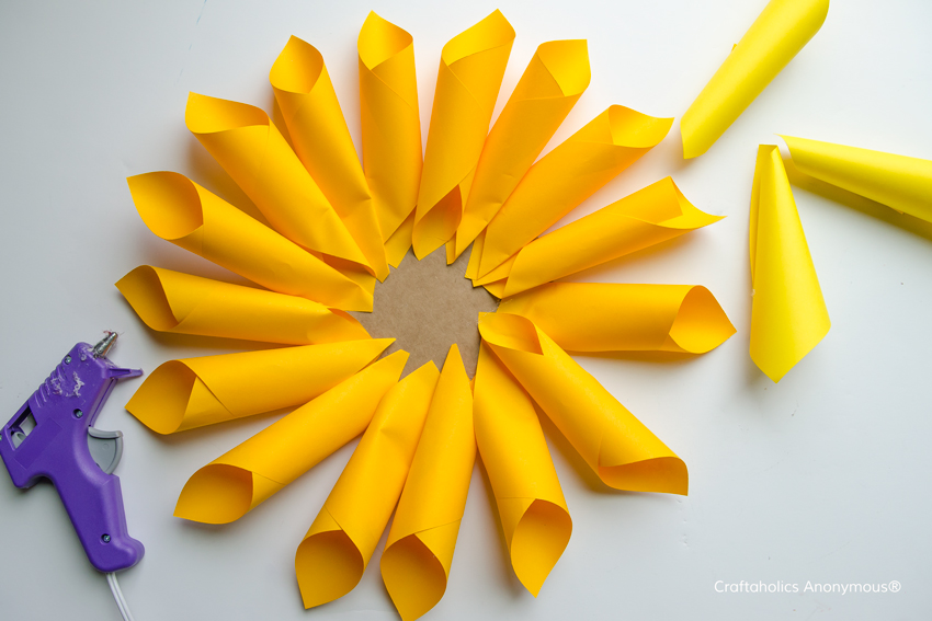 How to make Paper Dahlia flowers || Love how she them in all colors of the rainbow. Made such a pretty spring decoration