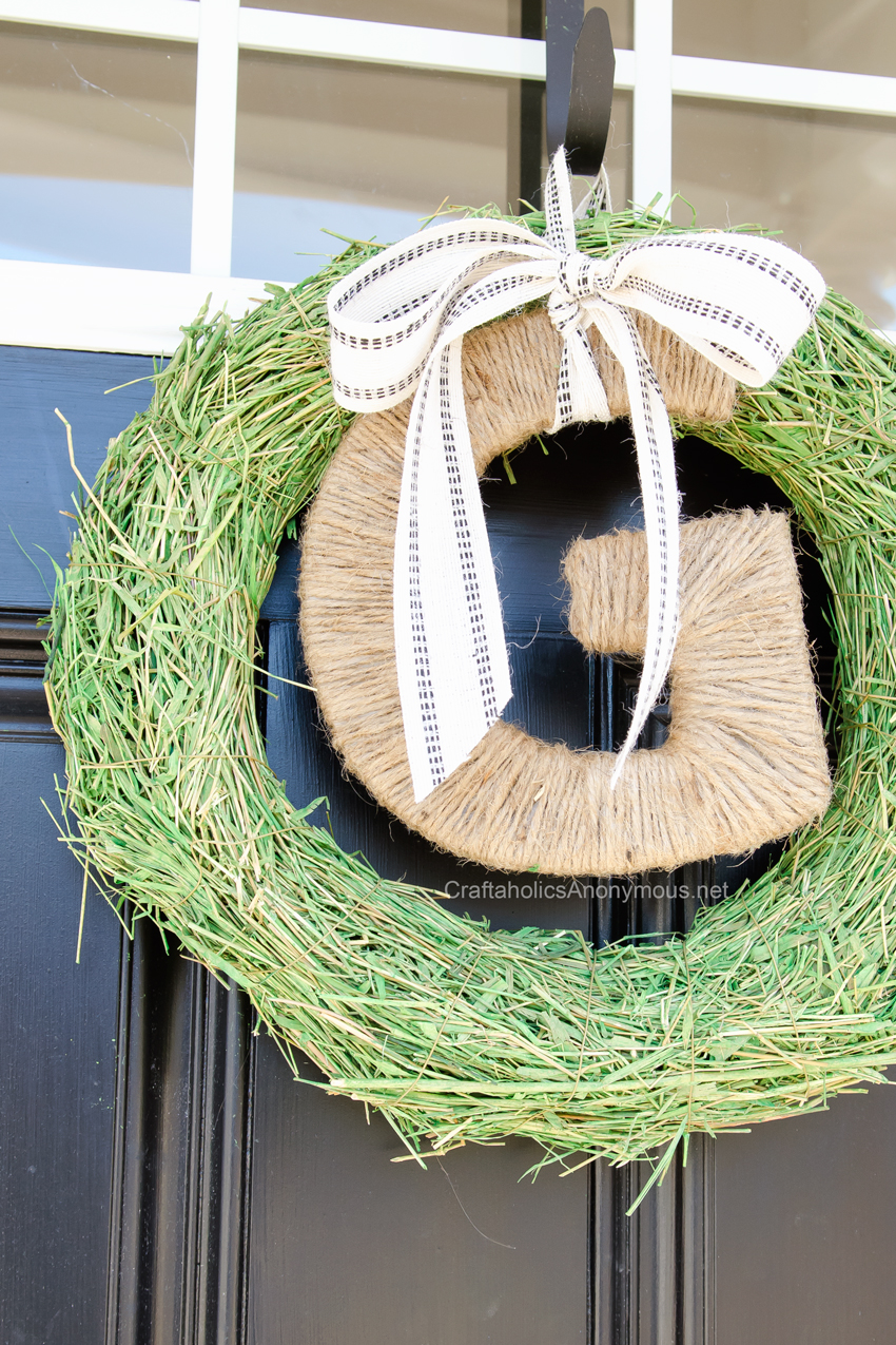 Monogram spring wreath || Love the twine letter and grass wreath form!
