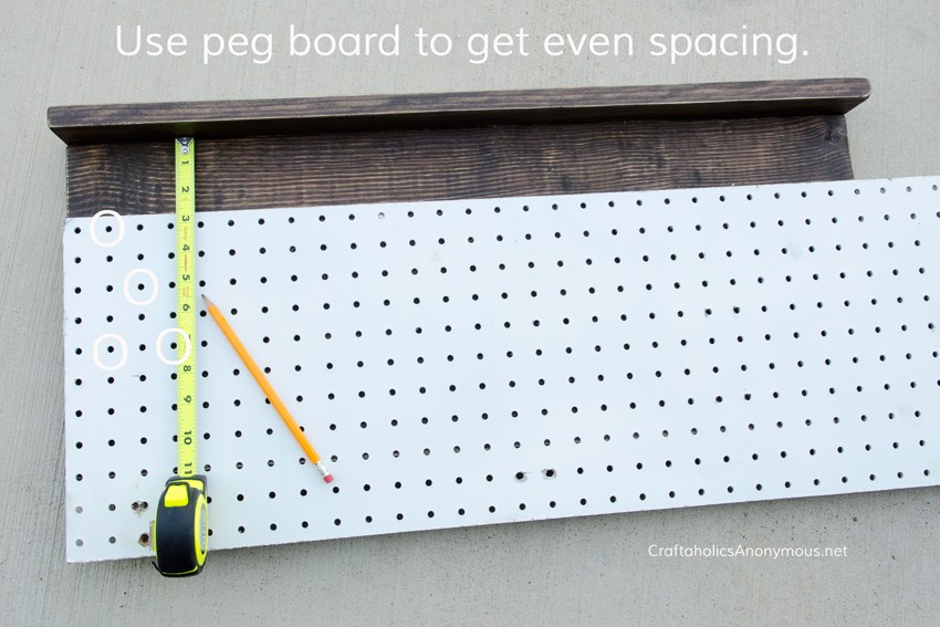 DIY Tie Rack || Use pegboard as a guide to evenly mark where each nail goes