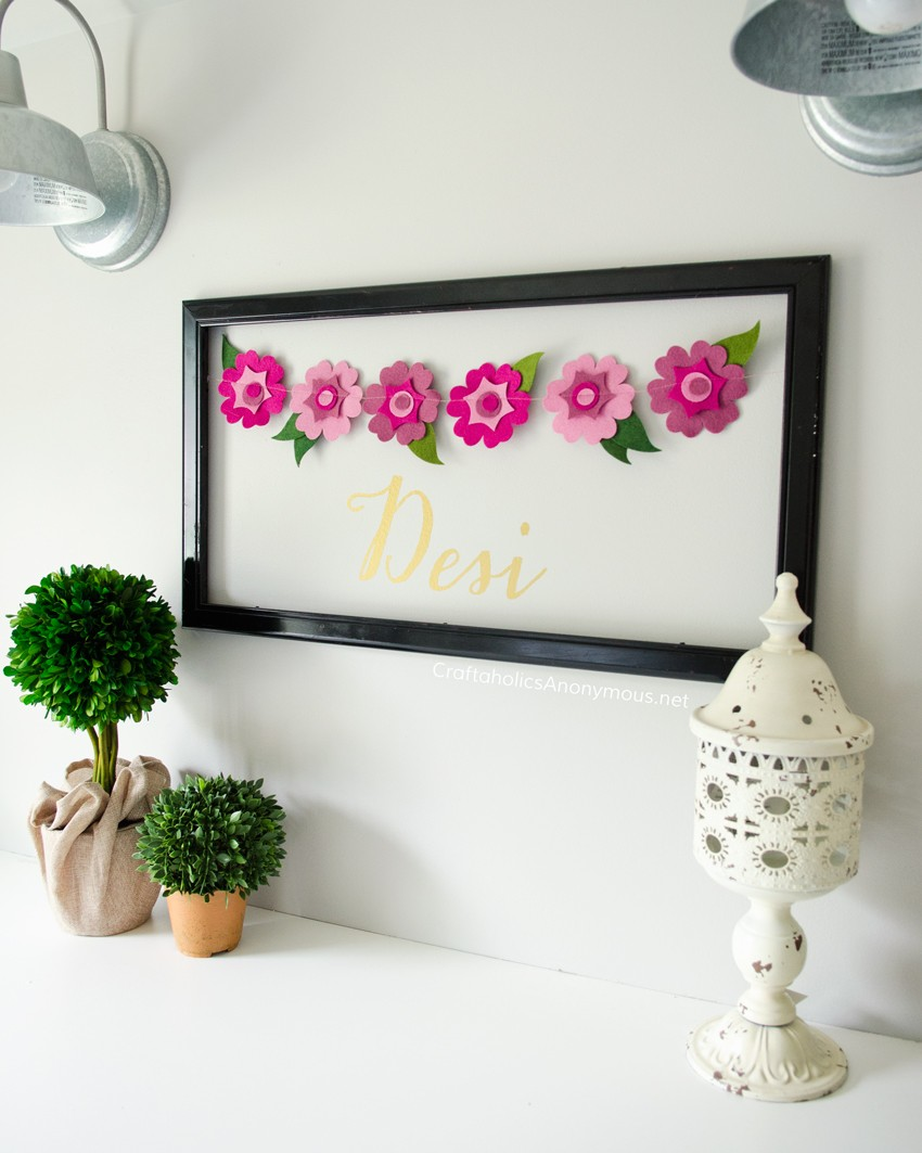 Love this cute DIY name decoration for a kids room! Could change flowers to soccer balls or something for boys.
