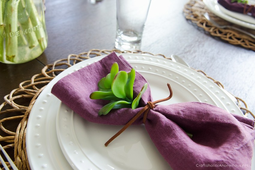 Slip a faux succulent into the napkin for a pop of color