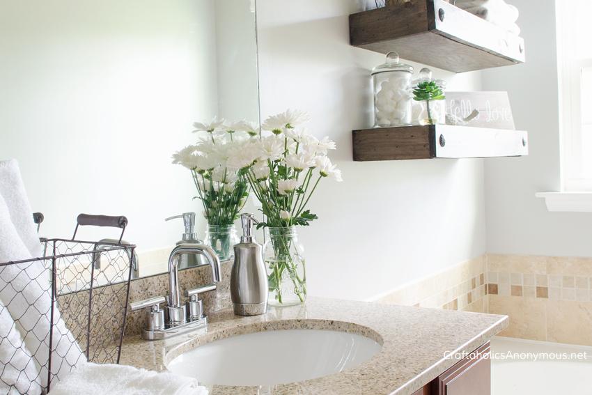 DIY Bathroom makeover || loving those floating shelves!