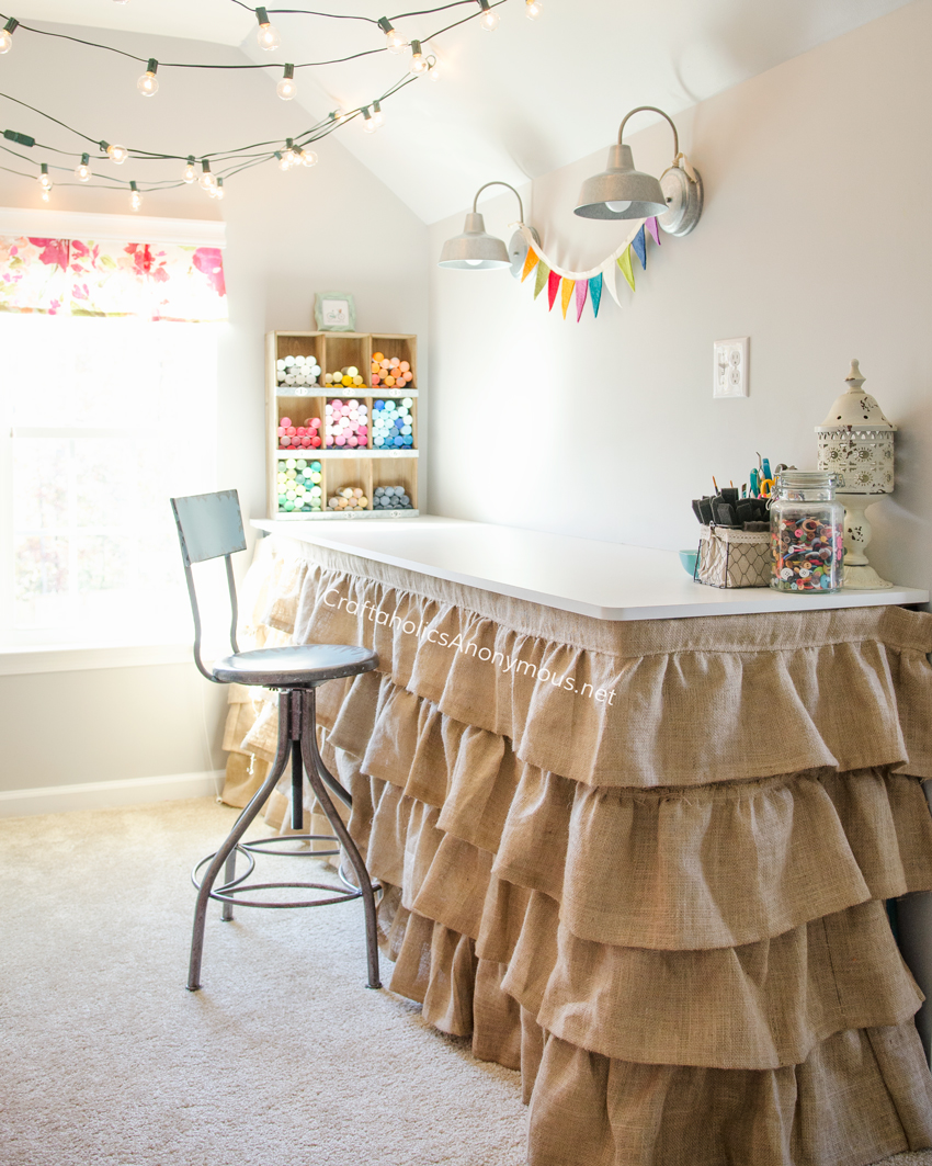 Craft Room desk with ruffled burlap skirt. Great idea to hide storage underneath the desk. Take a tour of the Dream Craft Room www.craftaholicsanonymous.net