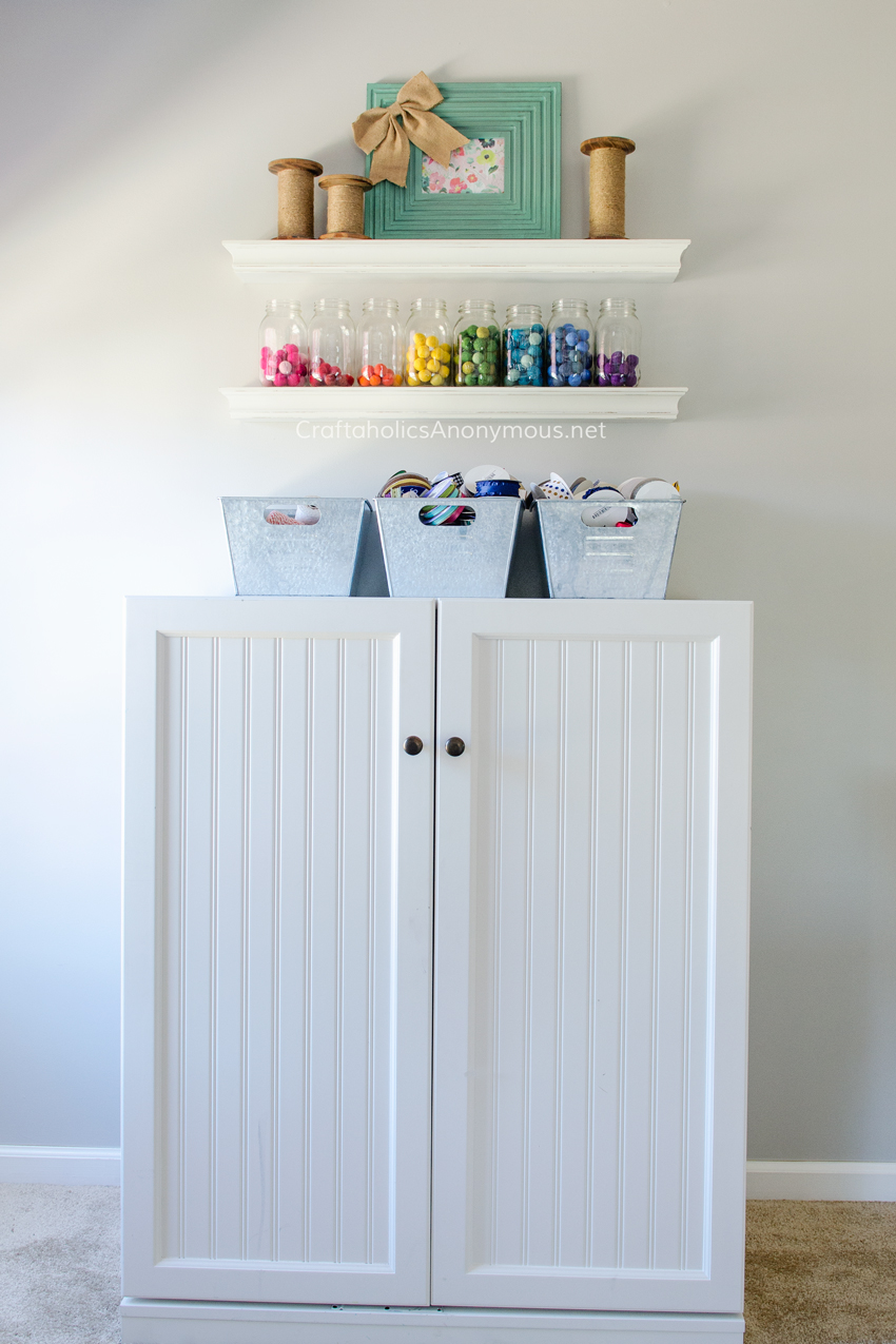 Sewing Cabinet in the most amazing craft room ever. Lots of Craft Room storage ideas on www.CraftaholicsAnonymous.net