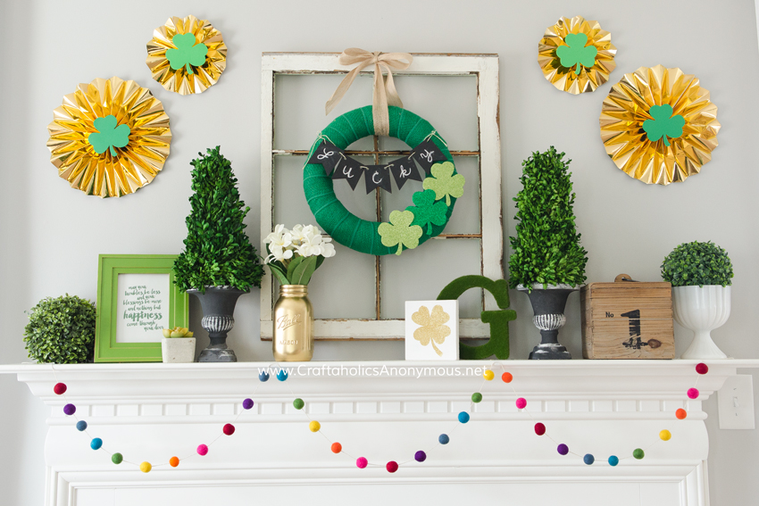 St. Patrick's Day Mantle scape. That rainbow felt ball garland is to die for!