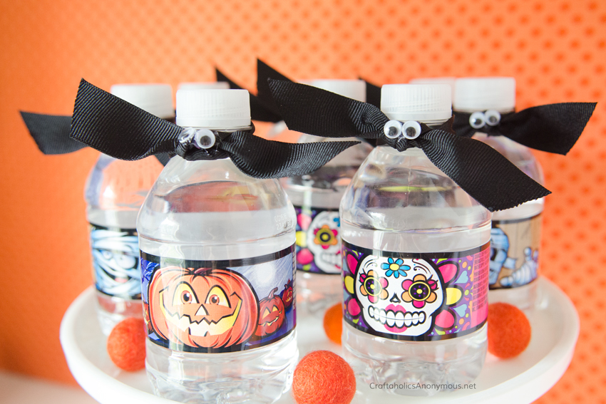 Halloween bat water bottle toppers. Super easy! Just use googly eyes and black ribbon.