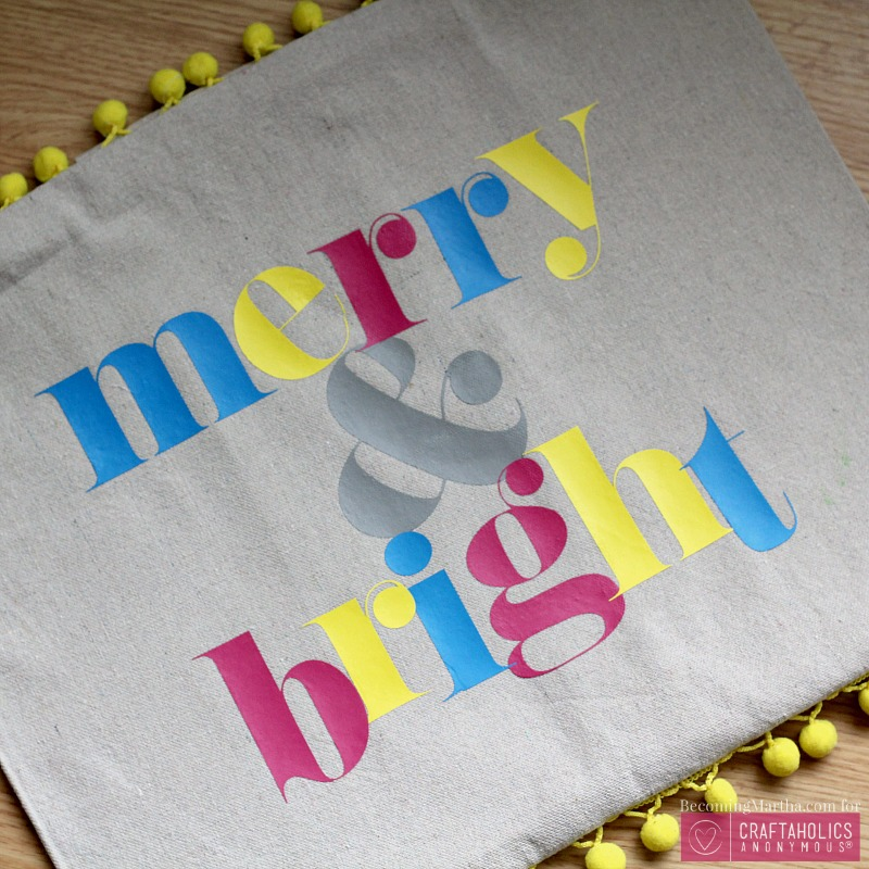 merry and bright pom pom pillow